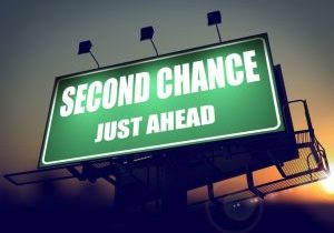 Image of Second Chance Just Ahead - Green Billboard on the Rising Sun Background image